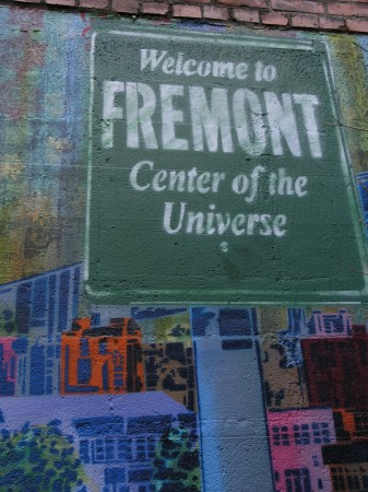 "Photo of painting that reads ""Welcome to Fremont -- Center of the Universe"""